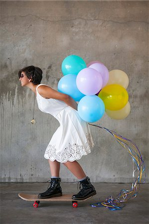 Teen with balloons Stock Photo - Premium Royalty-Free, Code: 618-08063741