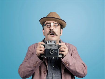 Nerd photographer Stock Photo - Premium Royalty-Free, Code: 618-08173628