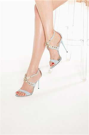 foot model - Young woman wearing high heels, low section Stock Photo - Premium Royalty-Free, Code: 618-08173633
