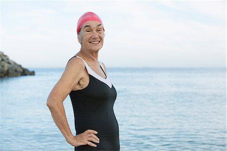 seniors and swim cap - Senior women posing at beach one piece swim suit Stock Photo - Premium Royalty-Free, Code: 618-08388698
