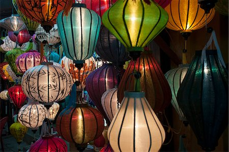 Vietnamese silk lanterns illuminated at night. Stock Photo - Premium Royalty-Free, Code: 618-08637707