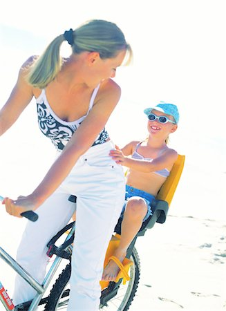 mother and daughter riding bicycle on the beach Stock Photo - Premium Royalty-Free, Code: 618-00446299