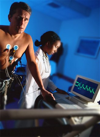 view of a young man getting a treadmill test done Stock Photo - Premium Royalty-Free, Code: 618-00447674