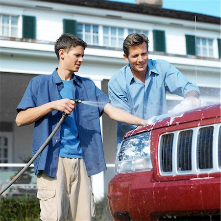 portrait of a father and son washing the car together Stock Photo - Premium Royalty-Free, Code: 618-00459192