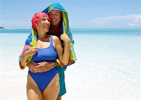 seniors woman in swimsuit - portrait of a elderly man hugging his wife at the beach Stock Photo - Premium Royalty-Free, Code: 618-00464910