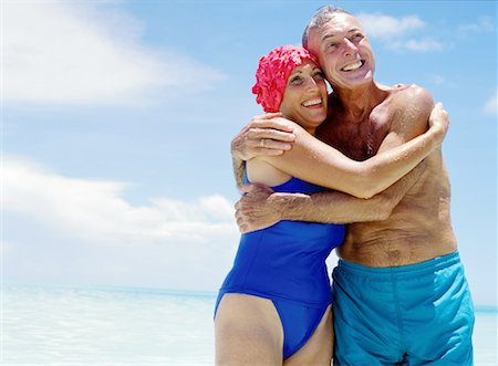 seniors woman in swimsuit - portrait of a mature couple hugging each other at the beach Stock Photo - Premium Royalty-Free, Code: 618-00464911