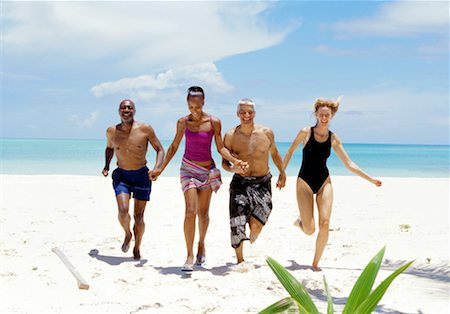 seniors woman in swimsuit - portrait of two couples running on the beach Stock Photo - Premium Royalty-Free, Code: 618-00464945
