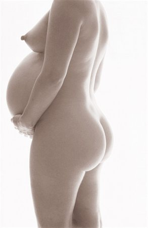 pregnant nipples - side profile of a nude pregnant woman holding her stomach (toned) Stock Photo - Premium Royalty-Free, Code: 618-00463203