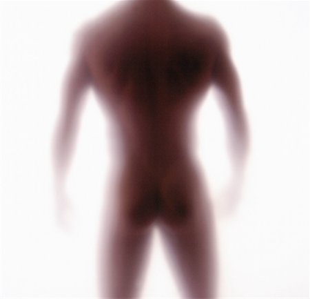 blurred rear view of a nude man standing Stock Photo - Premium Royalty-Free, Code: 618-00463215