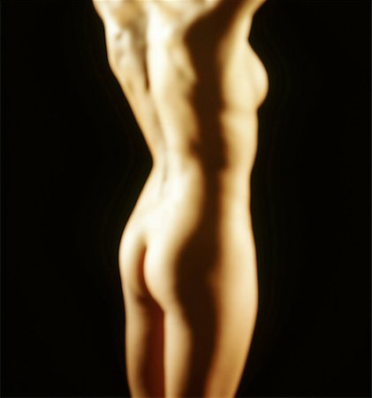 blurred shot of a nude woman standing Stock Photo - Premium Royalty-Free, Code: 618-00463277