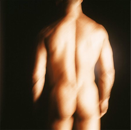 rear view blurred shot of a nude man standing Stock Photo - Premium Royalty-Free, Code: 618-00463280