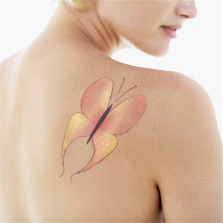 tattoo of butterfly on woman's shoulder Stock Photo - Premium Royalty-Free, Code: 618-00488862