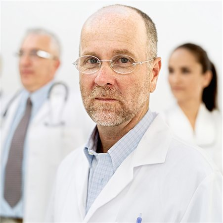 portrait of a male doctor thinking Stock Photo - Premium Royalty-Free, Code: 618-00489231