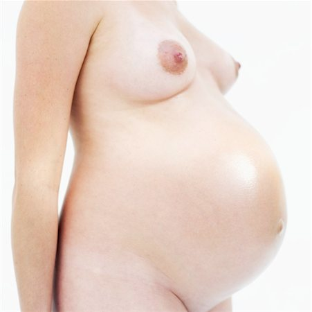 mid section view of a naked pregnant woman Stock Photo - Premium Royalty-Free, Code: 618-00497258