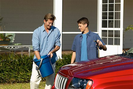 Father and teenage son (18-20) washing a car together Stock Photo - Premium Royalty-Free, Code: 618-00499929