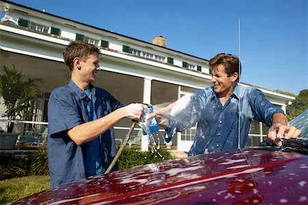 Father and teenage son (18-20) washing a car together Stock Photo - Premium Royalty-Free, Code: 618-00499931