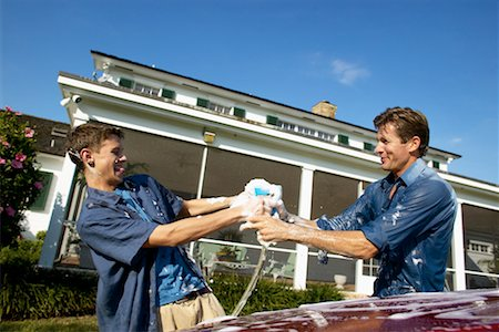 Father and teenage son (18-20) washing a car together Stock Photo - Premium Royalty-Free, Code: 618-00499933