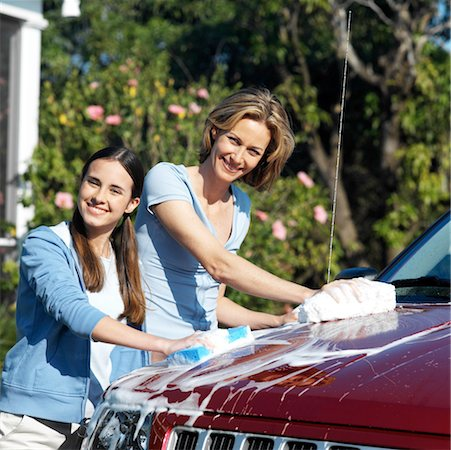 Portrait of a mother and teenage daughter (17-18) washing the car Stock Photo - Premium Royalty-Free, Code: 618-00499947