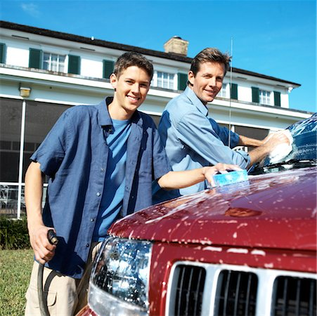 Portrait of a father and teenage son (18-20) washing the car Stock Photo - Premium Royalty-Free, Code: 618-00499949