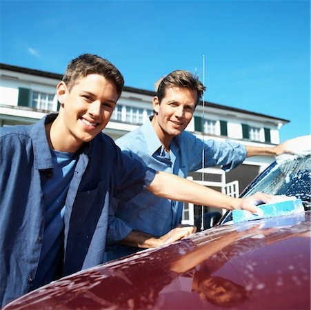 Portrait of a father and teenage son (18-20) washing the car Stock Photo - Premium Royalty-Free, Code: 618-00499950