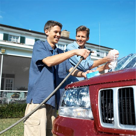 Portrait of a father and teenage son (18-20) washing the car Stock Photo - Premium Royalty-Free, Code: 618-00499951