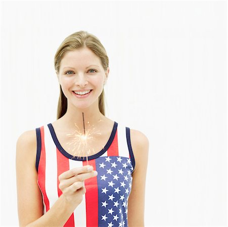 fireworks white background - Portrait of a young woman holding a burning sparkler Stock Photo - Premium Royalty-Free, Code: 618-00505268