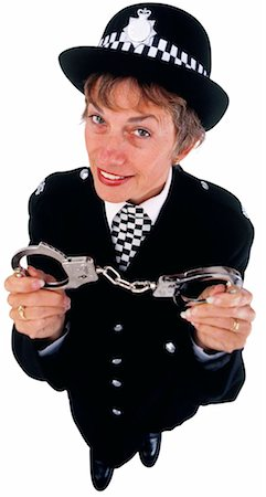female police officer happy - Portrait of a policewoman holding a pair of handcuffs Stock Photo - Premium Royalty-Free, Code: 618-00501113