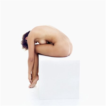 Nude young woman sitting on a box Stock Photo - Premium Royalty-Free, Code: 618-00503280