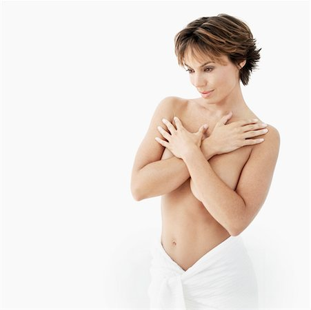 portrait of a mid adult woman covering her breast with her arms Stock Photo - Premium Royalty-Free, Code: 618-00503519