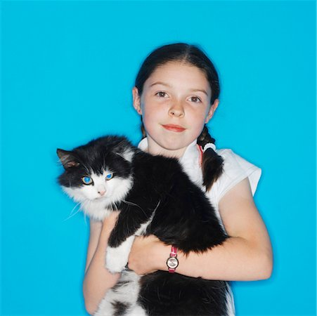 preteen girl pussy - portrait of a girl (7-8) holding a cat Stock Photo - Premium Royalty-Free, Code: 618-00510354