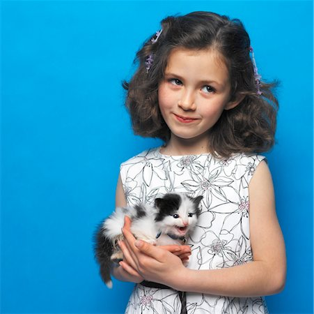 preteen girl pussy - girl (7-9) holding a kitten Stock Photo - Premium Royalty-Free, Code: 618-00510357