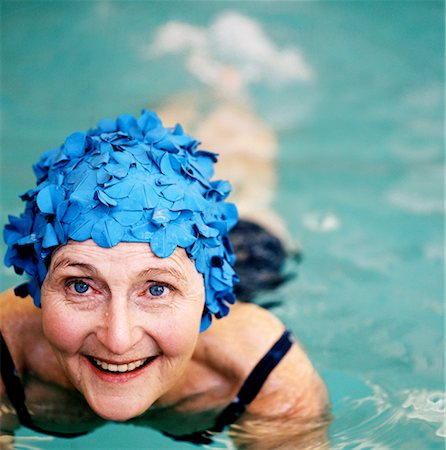 seniors and swim cap - Elderly woman smiling wearing a swimming cap in a swimming pool Stock Photo - Premium Royalty-Free, Code: 618-00512780