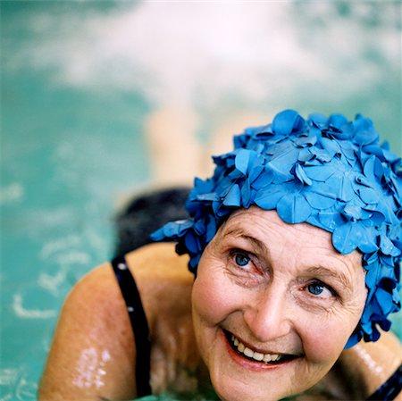 seniors and swim cap - elderly woman swimming in swimming pool wearing a swimming cap Stock Photo - Premium Royalty-Free, Code: 618-00512781