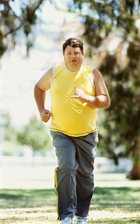 fat man exercising - portrait of a mid adult man jogging in a park Stock Photo - Premium Royalty-Free, Code: 618-00669117