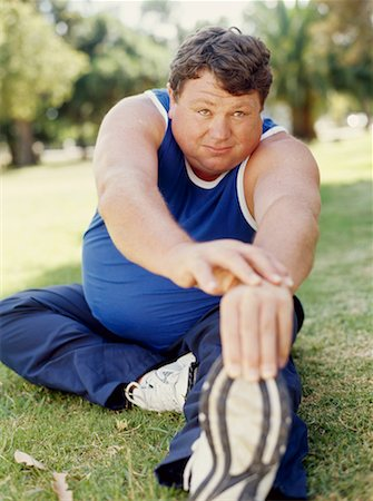 fat man exercising - mid adult man exercising in a park Stock Photo - Premium Royalty-Free, Code: 618-00669190