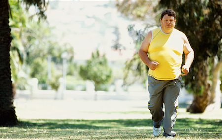 fat man exercising - portrait of a mid adult man jogging in a park Stock Photo - Premium Royalty-Free, Code: 618-00669205