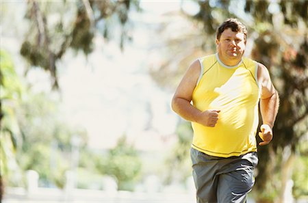 fat man exercising - portrait of a mid adult man jogging in a park Stock Photo - Premium Royalty-Free, Code: 618-00669206