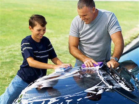 high angle view of a father and his son washing a car Stock Photo - Premium Royalty-Free, Code: 618-00689887