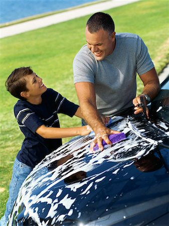 high angle view of a father and his son washing a car Stock Photo - Premium Royalty-Free, Code: 618-00689888