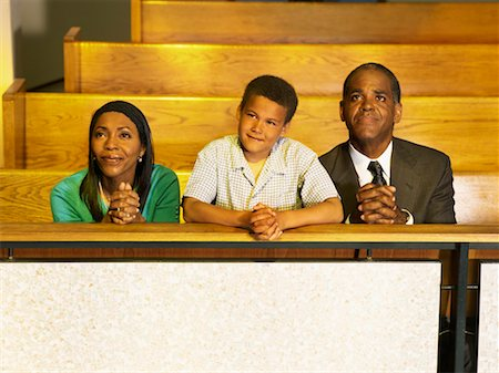 parents and their son praying in church Stock Photo - Premium Royalty-Free, Code: 618-00690071