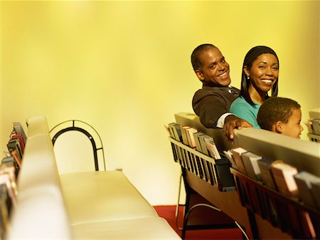 portrait of parents and their son smiling in a church Stock Photo - Premium Royalty-Free, Code: 618-00690073