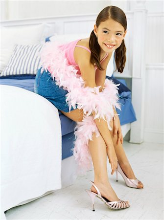 girl sitting on a bed Stock Photo - Premium Royalty-Free, Code: 618-00691189