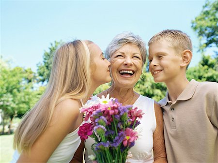 Two grandchildren kissing their grandmother Stock Photo - Premium Royalty-Free, Code: 618-00786515