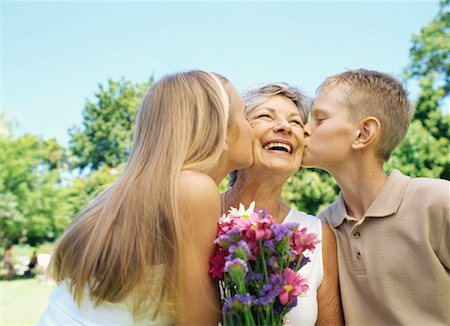 Two grandchildren kissing their grandmother Stock Photo - Premium Royalty-Free, Code: 618-00786516