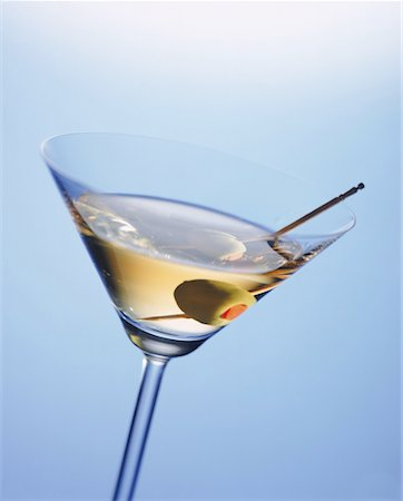 pimento - Martini glass with cocktail stick and green olive, close-up Stock Photo - Premium Royalty-Free, Code: 618-01044170