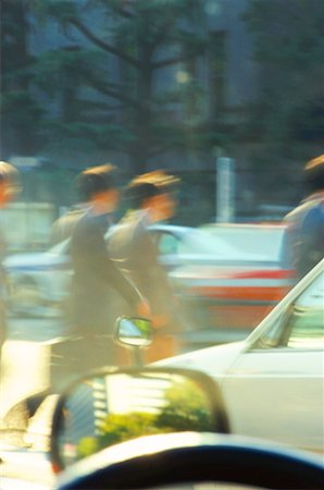 Businesspeople on parking lot (blurred motion) Stock Photo - Premium Royalty-Free, Code: 618-01053855
