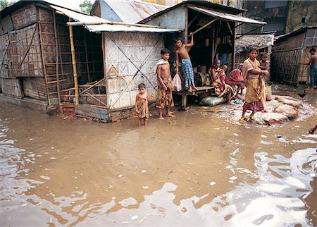 dhaka - Floodwaters surrounding houses in Dhaka,Bangladesh Stock Photo - Premium Royalty-Free, Code: 618-01245704