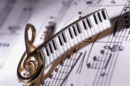 Close-up of a musical pin over sheet music Stock Photo - Premium Royalty-Free, Code: 618-01418926