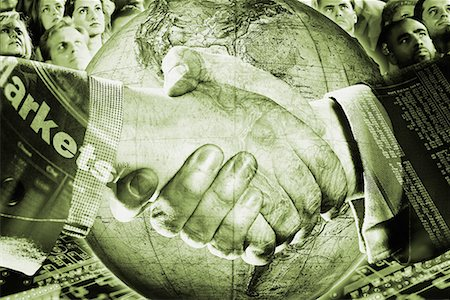 Two businessmen shaking hands over globe Stock Photo - Premium Royalty-Free, Code: 618-01421263