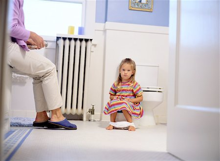 Girl Sitting on a Potty Chair Stock Photo - Premium Royalty-Free, Code: 618-01441011